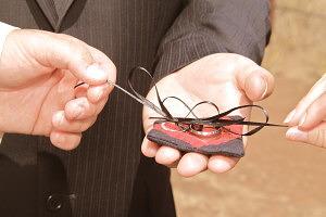 hands untying wedding rings for ring exchange